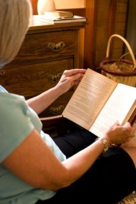 female-reading-book-at-home-361x544